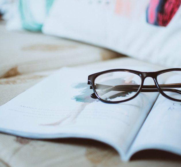 black-framed-eyeglasses-on-paper-1205292