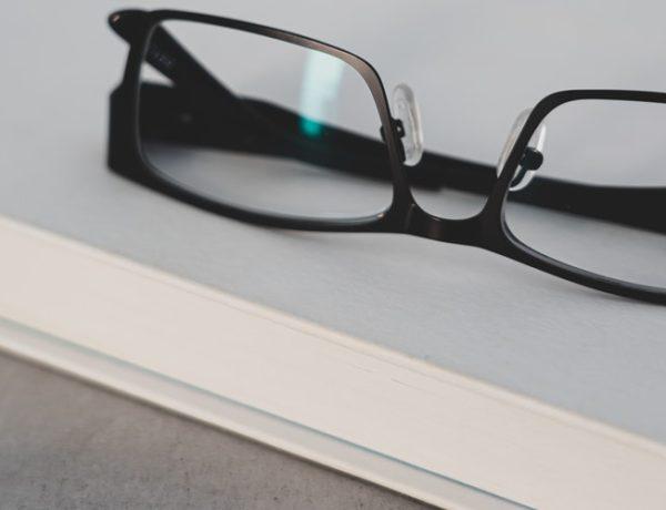 black-framed-eyeglasses-on-white-table-SICTOR OPTICAL